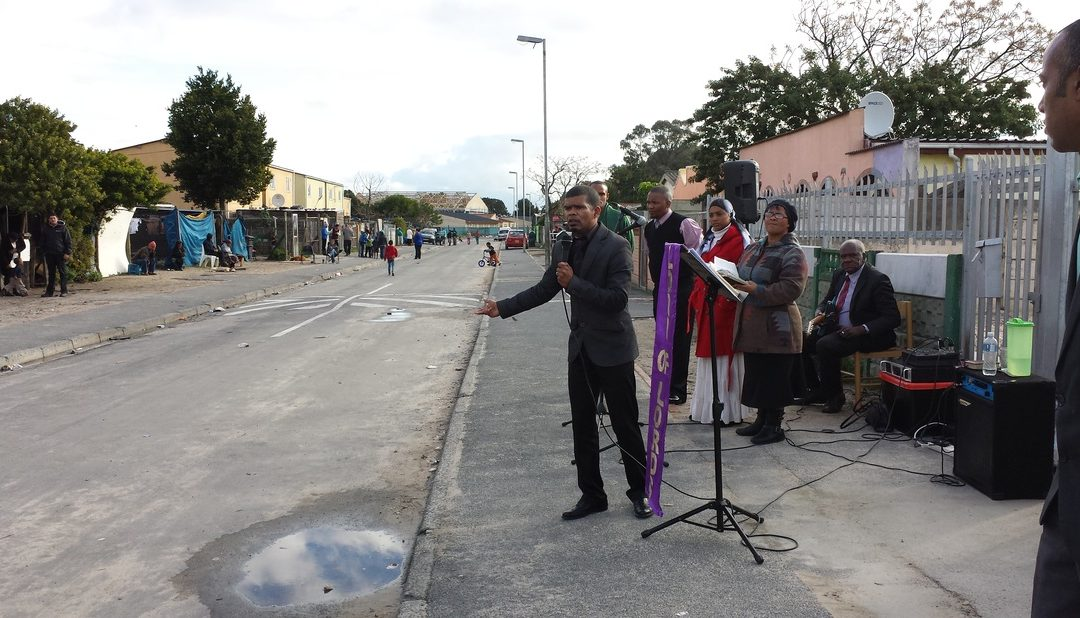 Pastor Quinton preaching the gospel in Cupido street, Bellville South.